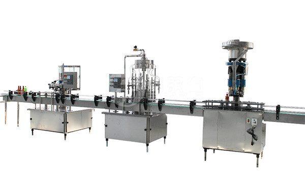 Mašina za zatvaranje i etiketiranje boca od 1 litre stakla